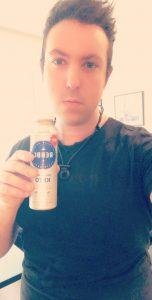 Eric Schleien holding a vanilla keto drink